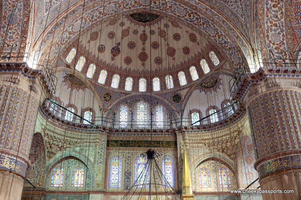 The beautiful designa of the Blue Mosque interior to visit during a layover in Istanbul