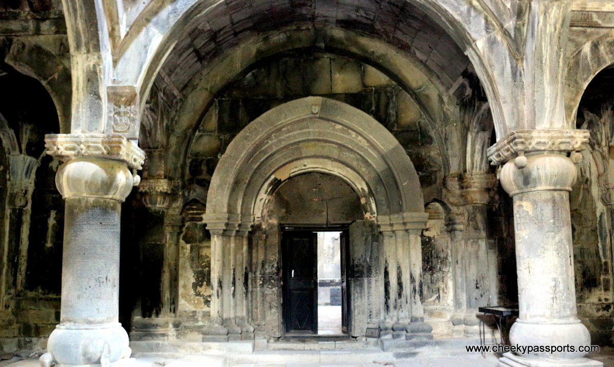 view of the rich arches and architectural decorations of the Sanahin monsatry in armenia. Part of it is darkened giving a mystical feeling (monasteries in Armenia)