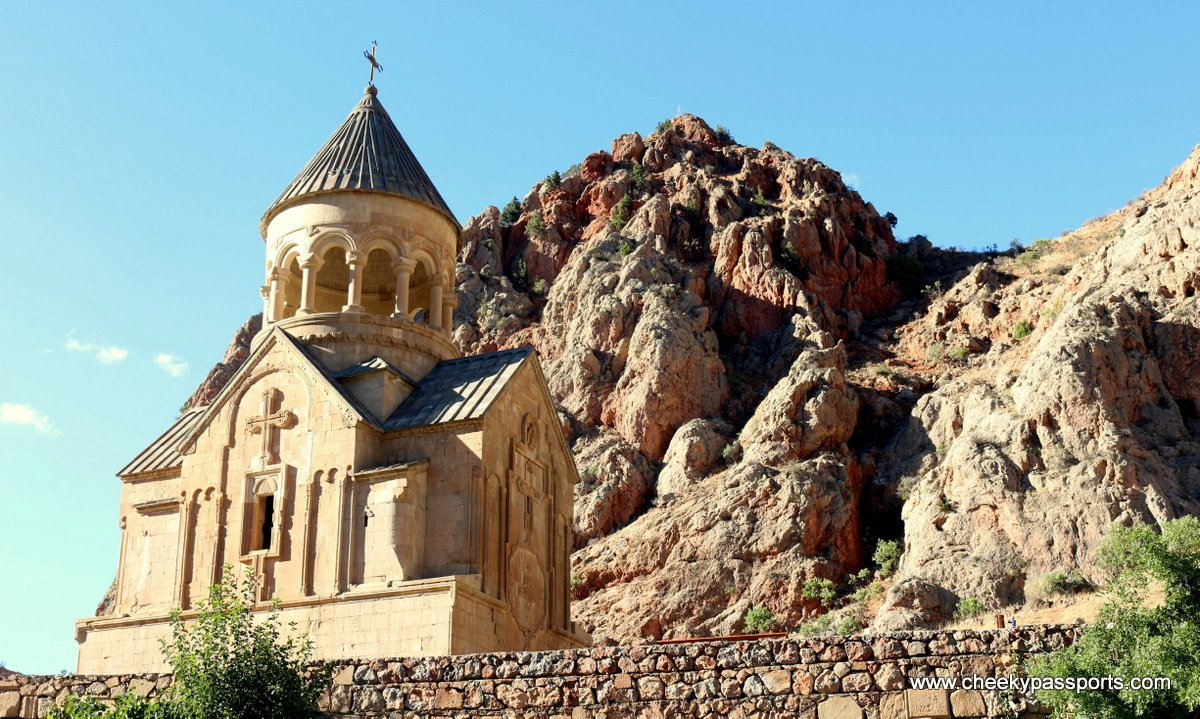 a view of the Novarank Monastery showing a background of the gorge walls. Armenian monastries
