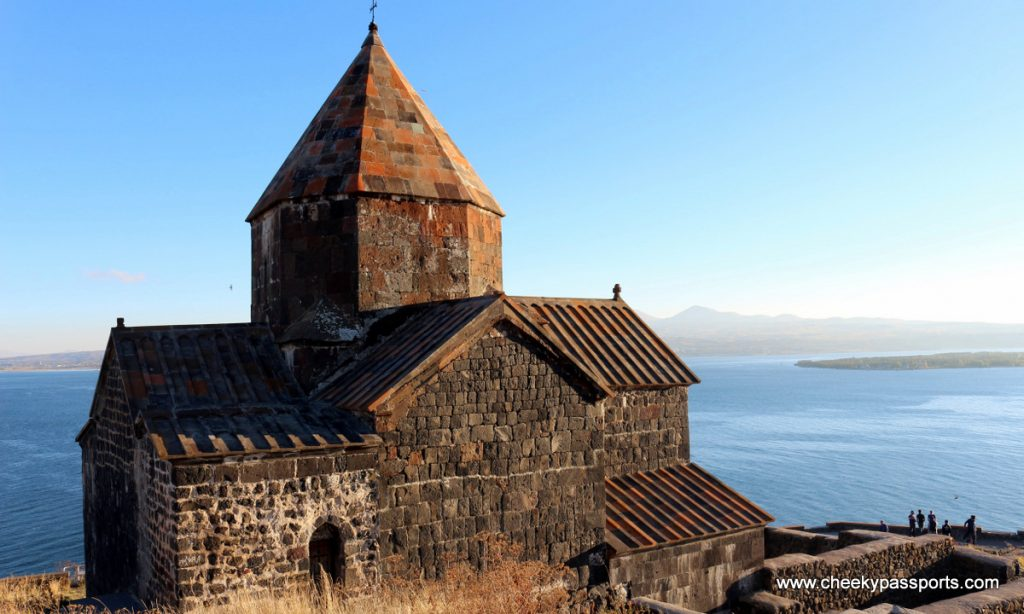 View of Sevenavank Monastery in beautiful Armenia overlooking the calm Lake Sevan below