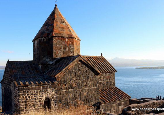 View of Sevenavank Monastery in Armenia overlooking the calm Lake Sevan below