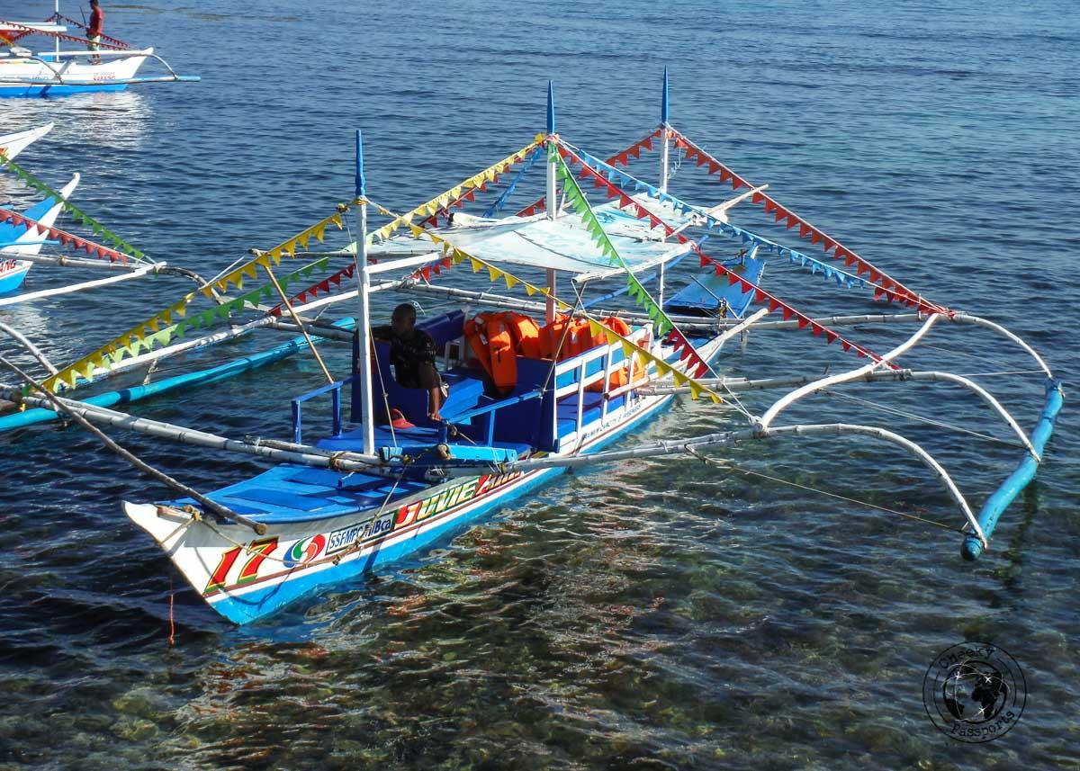 a colorful banka at Sabang ready to take visitors to the Puerto Princesa Underground River