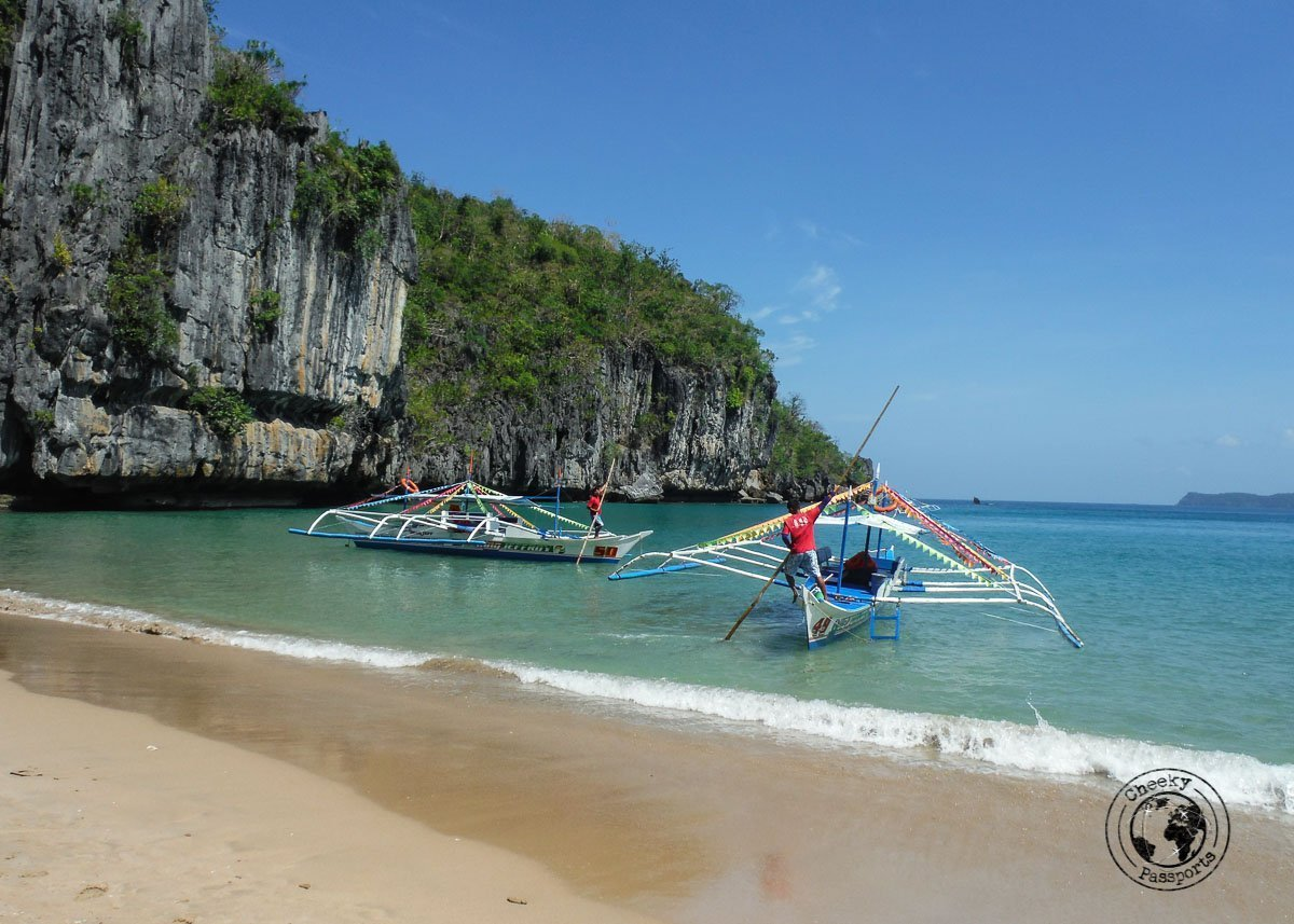 A remote beach in Sabang city featuring bankas, prior to entry at the Puerto Princesa Underground River