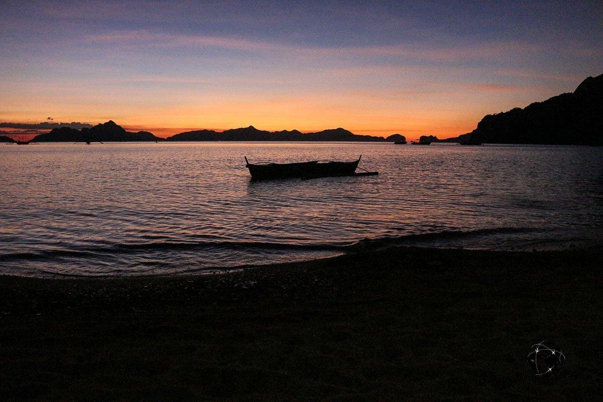 El Nido Itinerary - Sunset view at Corong-Corong featueing a banka