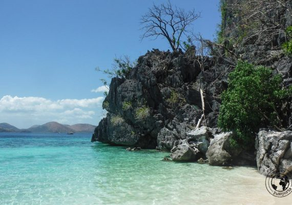 Highlights of Coron - a view of the rock cliff side over the sea at one of the islands visited during the tour