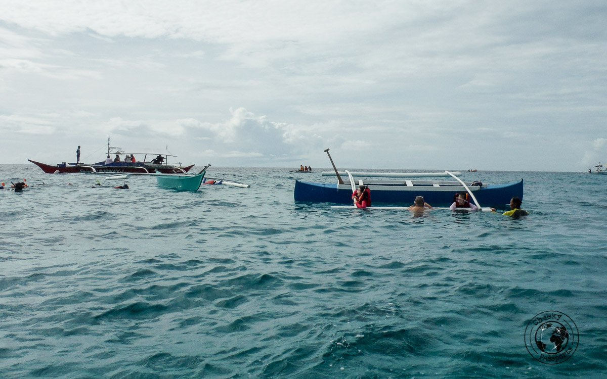Boats taking tourists turtle watching at Balicasag Island, Bohol - Why we won't recommend the Panglao island hopping tour