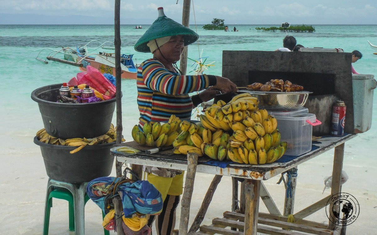 preparing food ontop of the sand dune at Virgin island, Panglao - Why we won't recommend Island hopping in Panglao