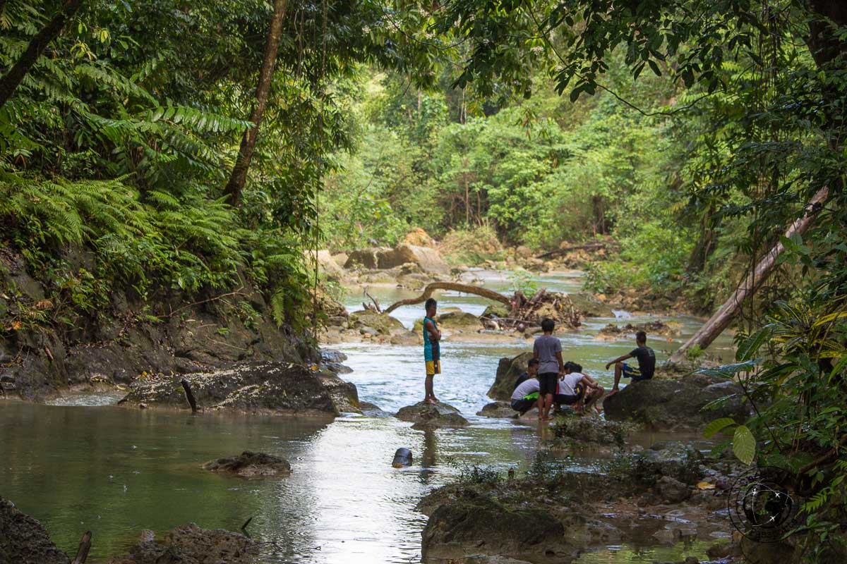 Mas-Aso falls view of children preparing a chicken for a bbq - the best and worst of Bohol