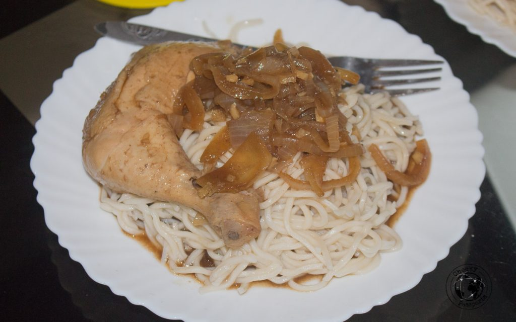 Chicken Adobo served over noodles