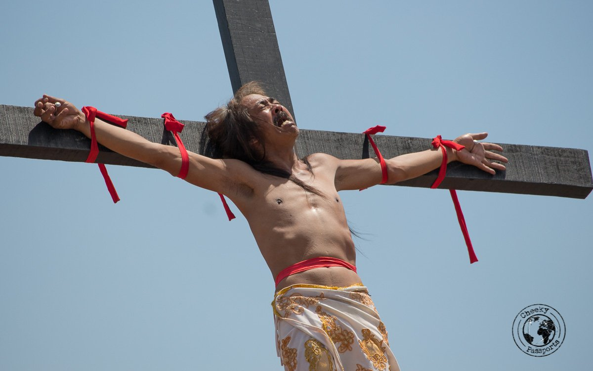 Christ impersonator in pain - crucifixion at san pedro cutud