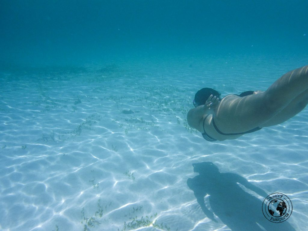 Michelle snorkling in the clear waters at Cresta de Gallo island, Sibuyan