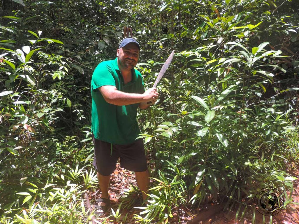 Nikki with a machete working his way in the dense forest of Sibuyan