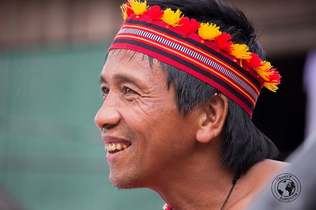 A man dressed in a typical costume posing at the Imbayah Festival in Banaue - the rice terraces of Banaue