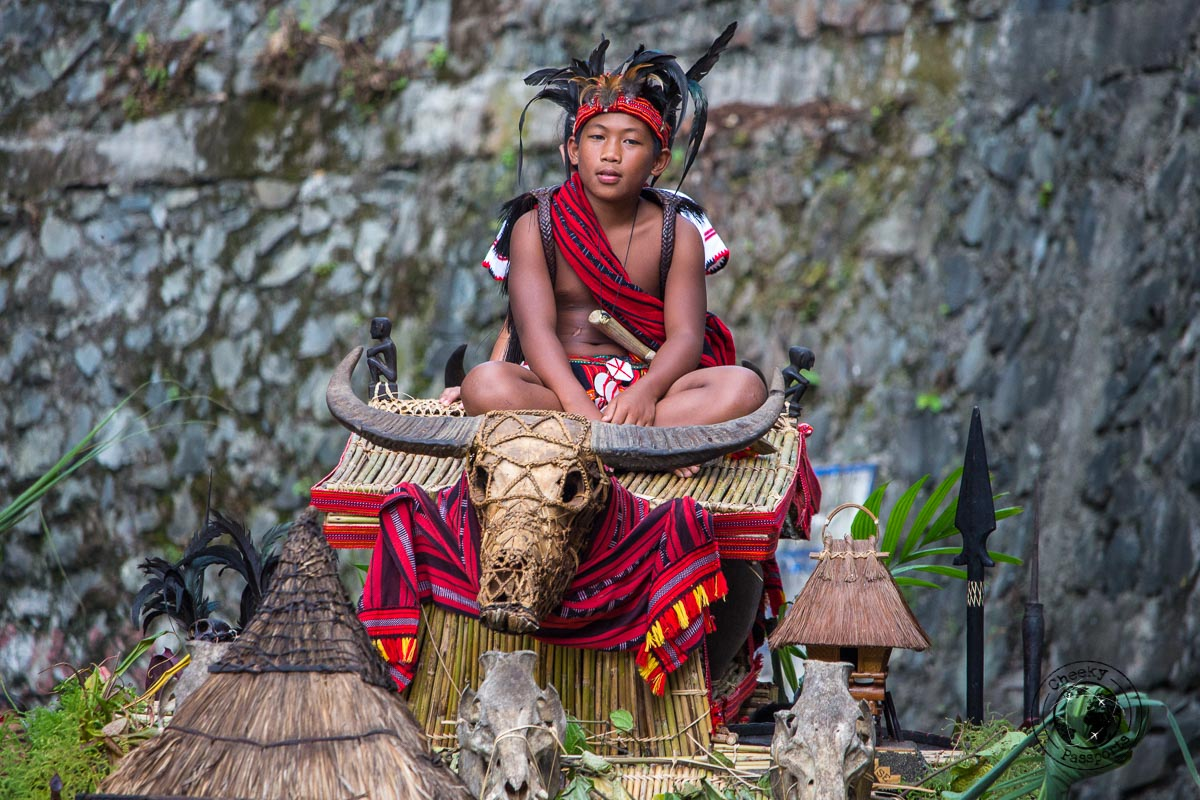 A child posing on top of a float at the Imbayah Festival in Banaue - the rice terraces of Banaue - traveling in southeast asia