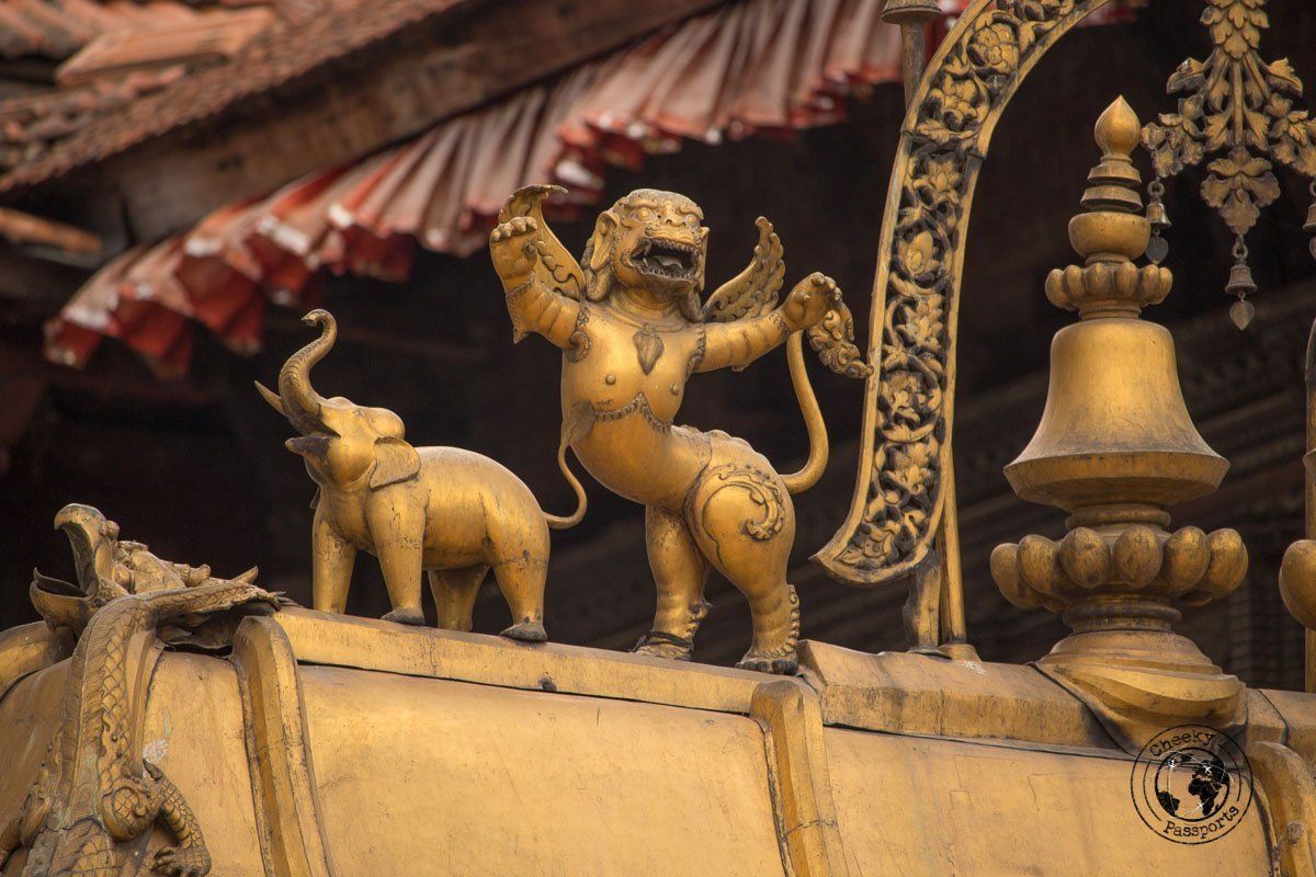 Intricate gilded figurines at the Golden Gate at Bhaktapur Durbar Square in Nepal