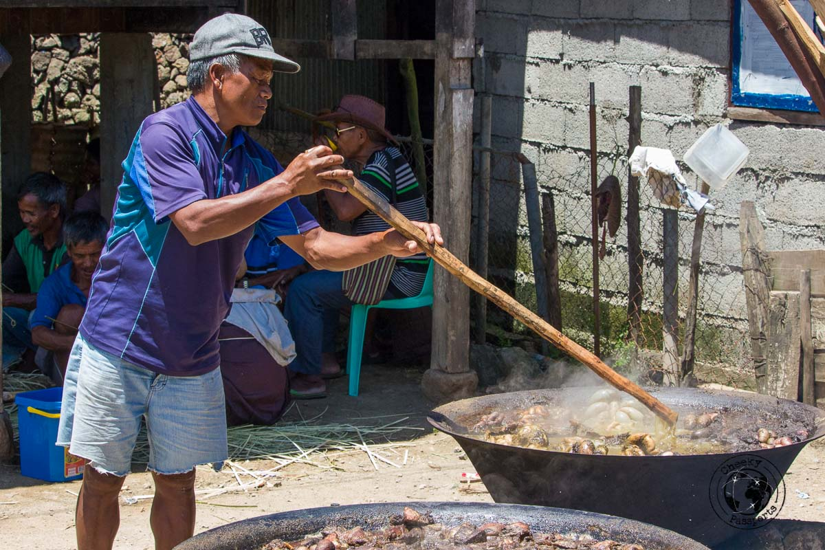 Sitrring the pots for the festival - meeting the kalinga tribe in buscalan