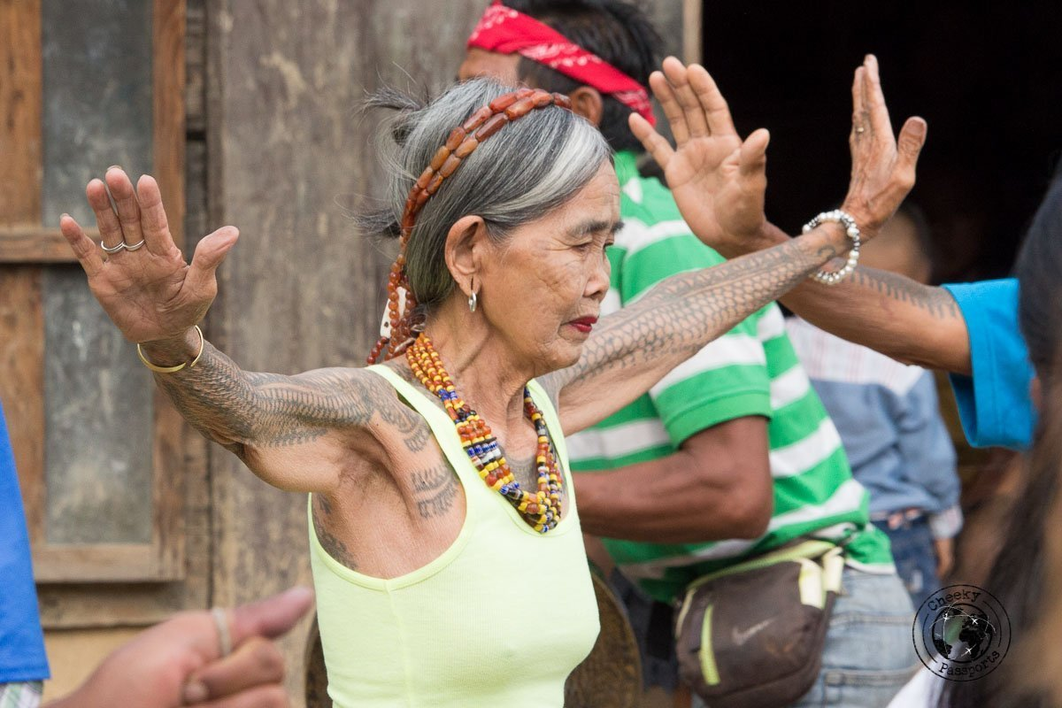 Legendery tattoo artists Whang-Od enjoying some moments at the festival - meeting the Kalinga Tribe in Buscalan