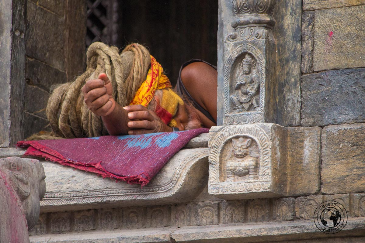 A sleeping Sadhu at the Pashupatinath temple - things to do in Kathmandu