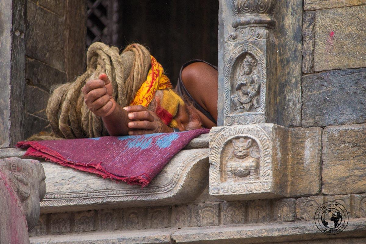 A sleeping Sadhu at the Pashupatinath temple - things to do in Kathmandu