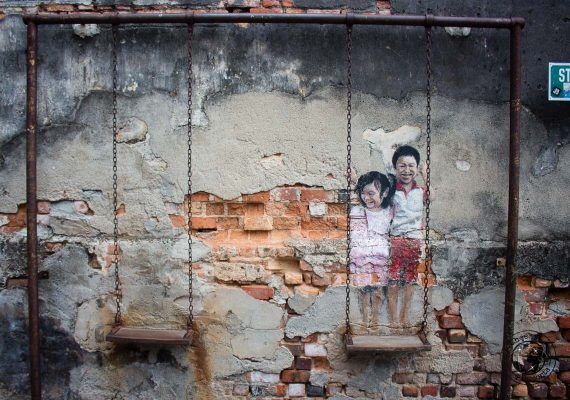 Brother and Sister on a swing - street art in penang