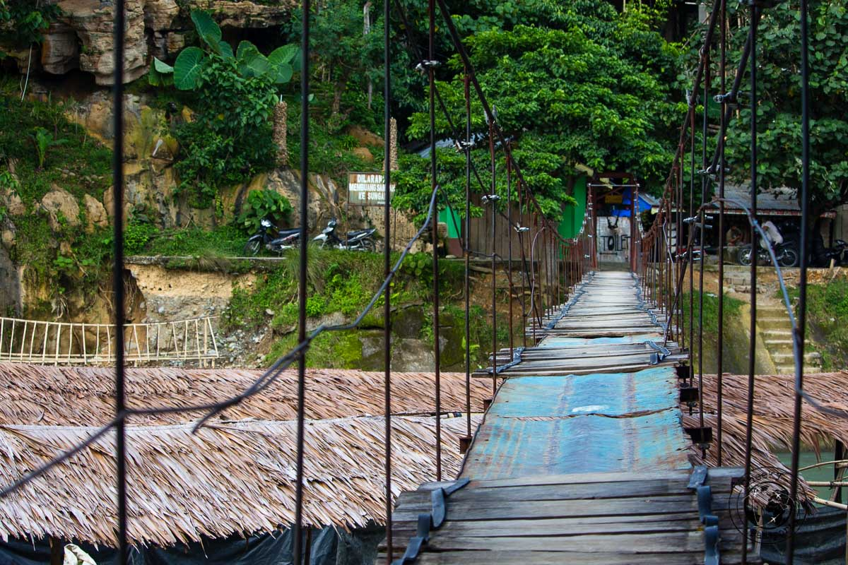Crossing the bridge - Bukit Lawang trekking
