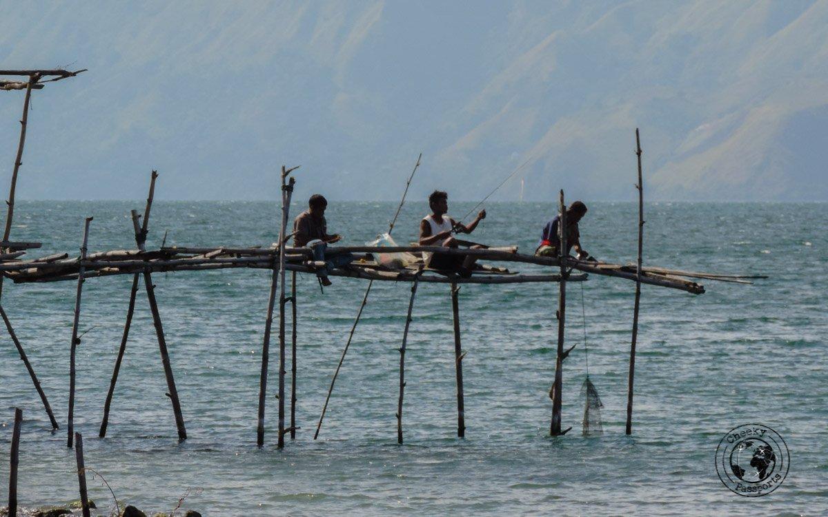 Fishermen at Pantai Sibolazi Lake Toba