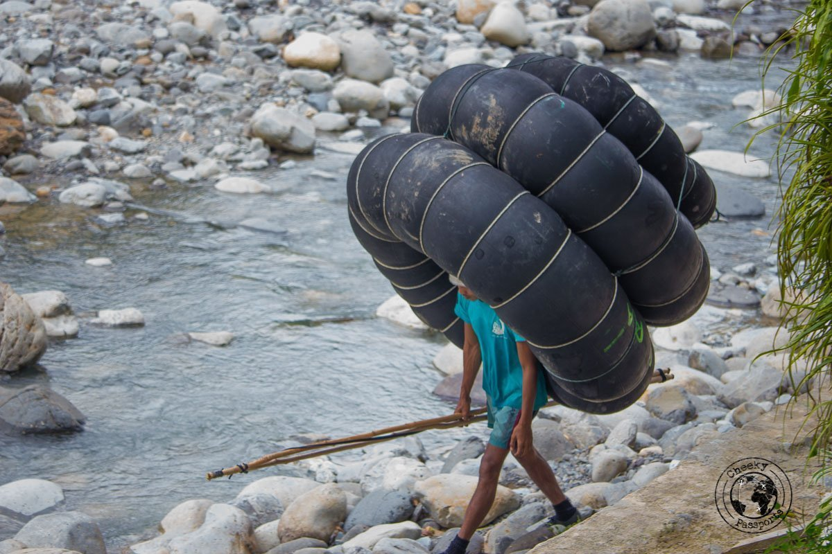 Human snail, a man carrying tires for rafting - Bukit Lawang trekking