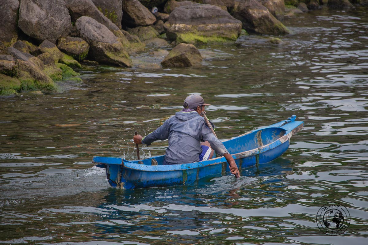 fisherman in the lake - A Guide to Lake Toba