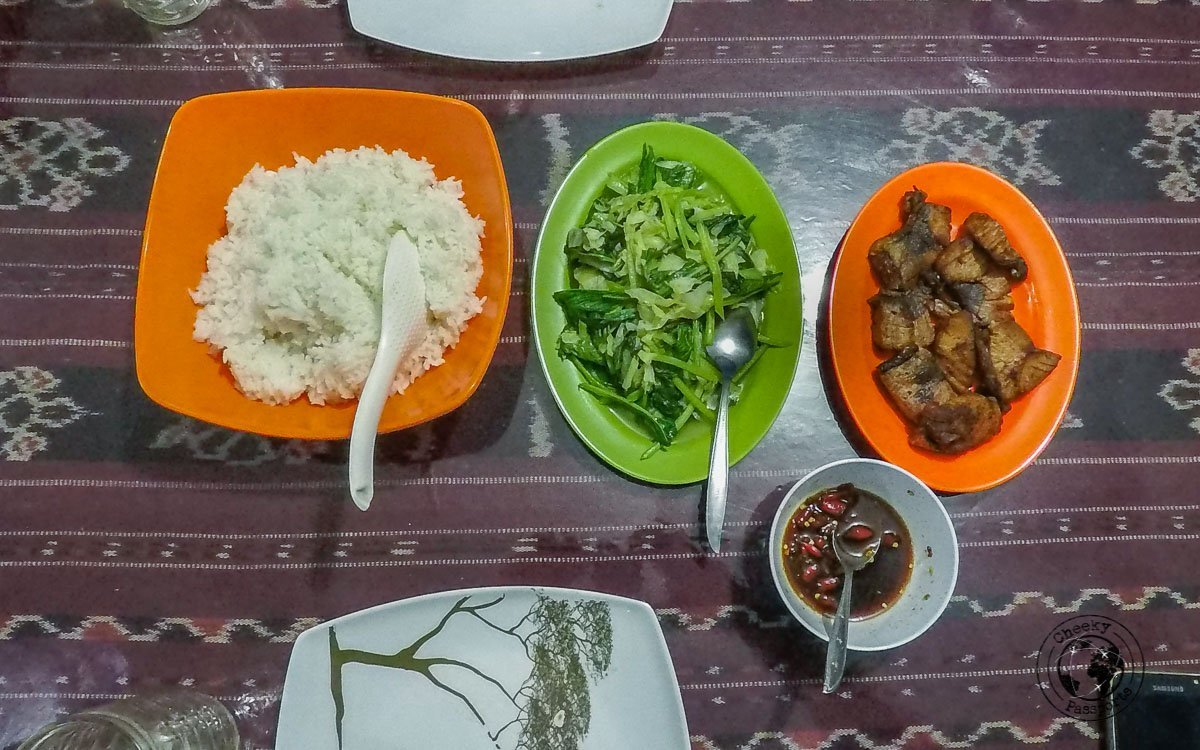 A simple dinner of fish and vegetables in Alor Island, Indonesia