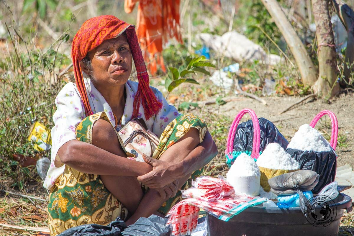 Meeting the Indonesian tribes. A Seller in the market at Desa Nusa which we visited whilst exploring west timor, indonesia. . West Timor Travel