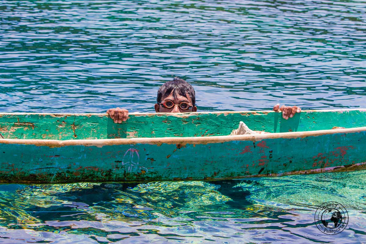 A fisherman and his boat with his homemade goggles off Banda ai, Spicing it up at the Banda Islands Maluku Indonesia