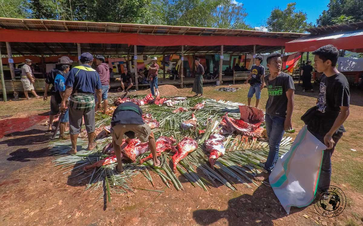 Cutting the offering up in pieces and distributing them to the family and friends is part of the custom traditions at Tana Toraja funerals