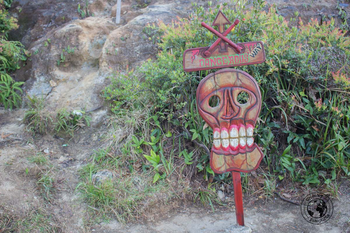 Eccentric warning signs at mount kelimutu park - travelling across Flores island Indonesia