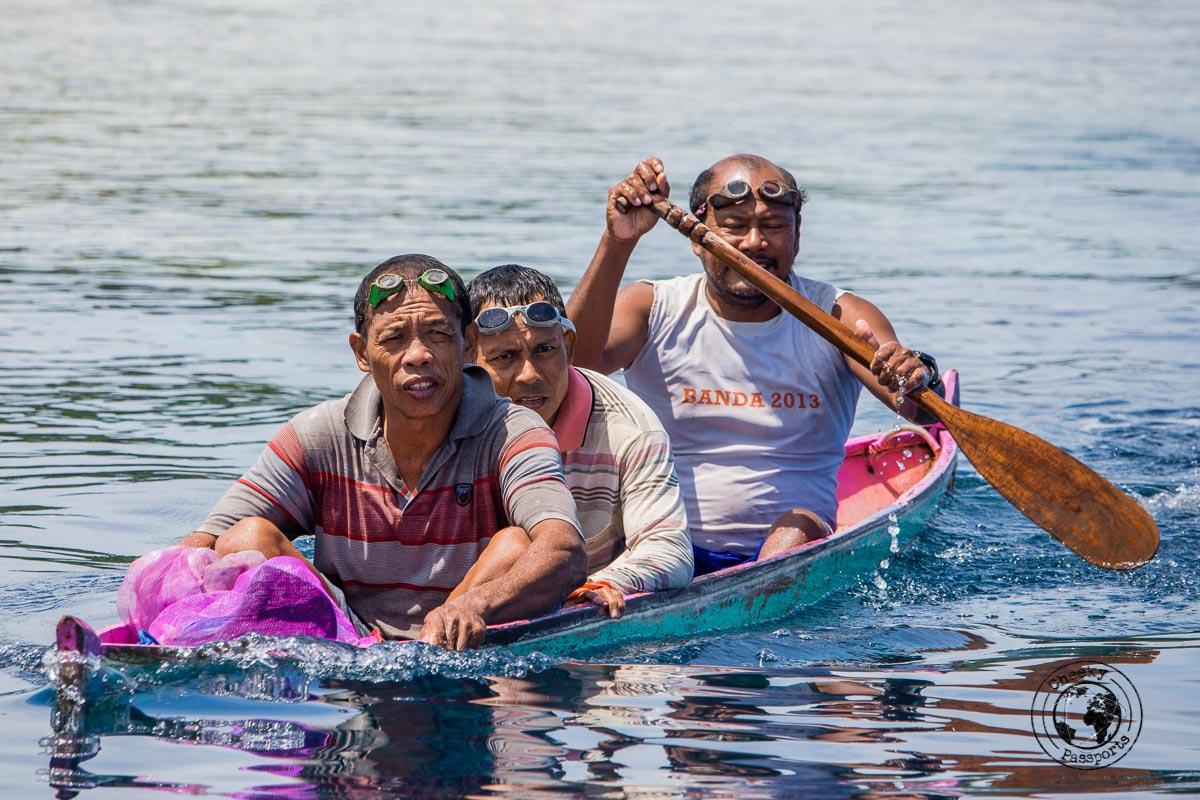 Fisherman sharing a small boat in Banda Islands, Maluku