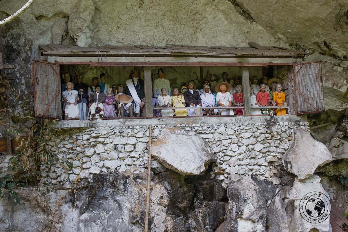 Londa burial site in Rantepao, Tana Toraja, Indonesia. The balcony hosts effigies of dead relatives overlooking the land