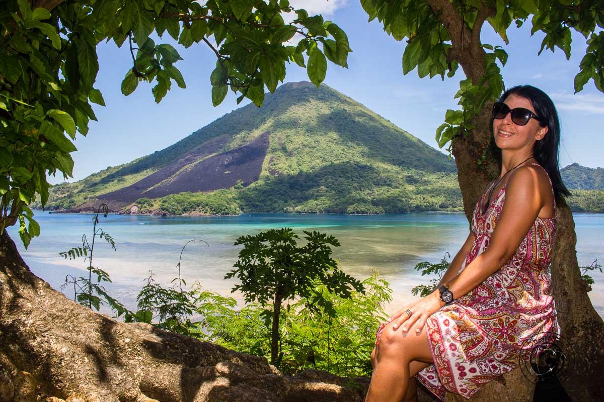 Michelle posing with Guning Api volcano in the background, Banda Islands, Maluku