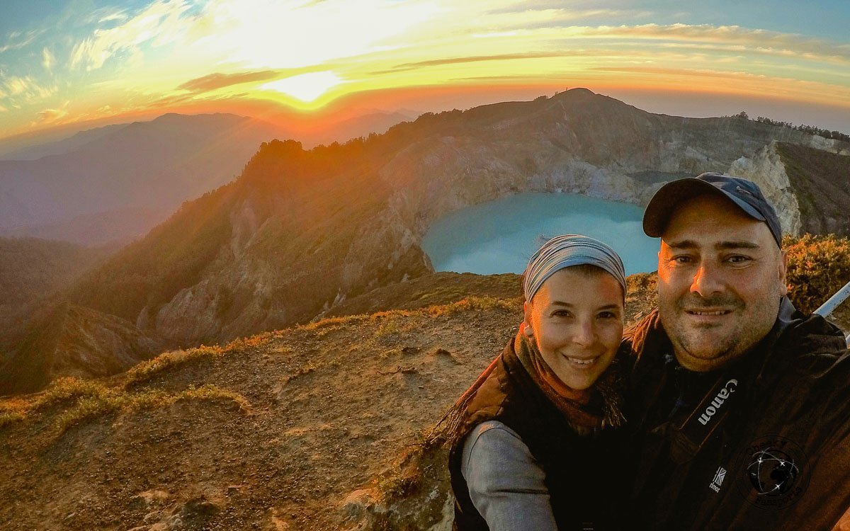 Nikki and Michelle from Cheekpassports enjoying a cold morning sunrise at mount Kelimutu - traveling across flores island indonesia