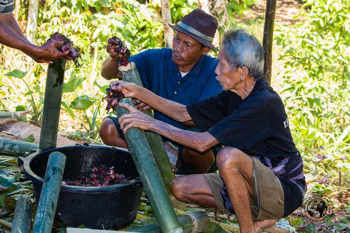 Preparing the Pa'Piong. A mix of meats and spices, steamed in a bamboo rod in Tana Toraja, Indonesia