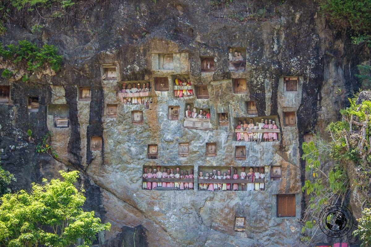 Tau Tau statuettes at the Lemo burial site near Rantepao in Tana Toraja, Indonesia