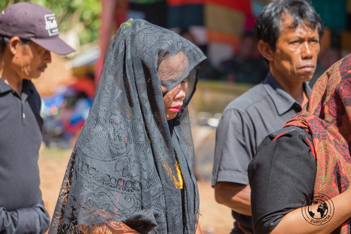 The opening procession of relatives walking past their audience all dressed in black, funeral in Tana Toraja, Indonesia