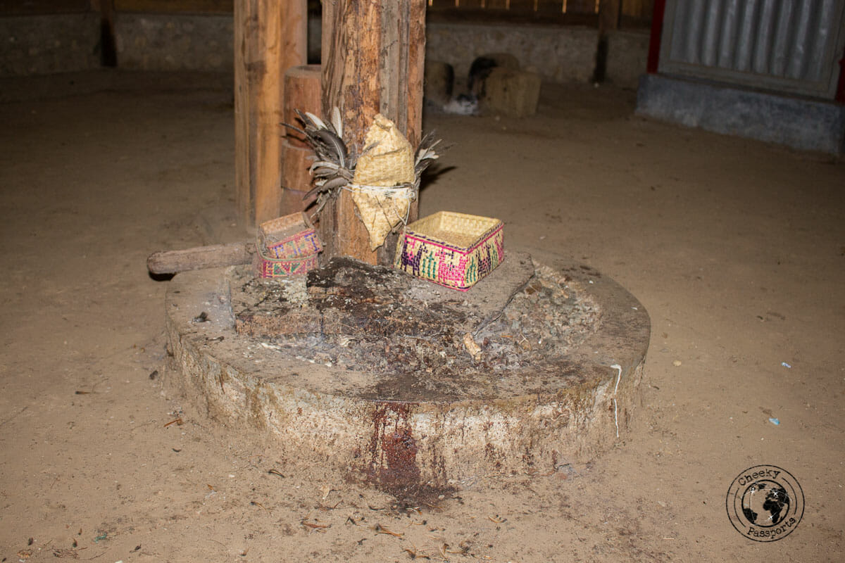 Exploring Indonesia - The sacrificial stone inside the magic house at the village of Maubesi which we visited whilst exploring west timor, indonesia