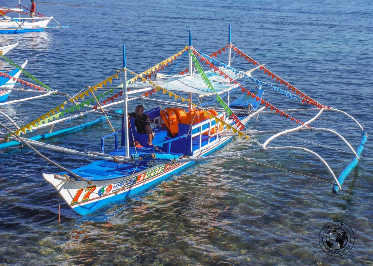 a colorful banka at Sabang ready to take visitors to the Puerto Princesa Underground River Tour Do It Yourself