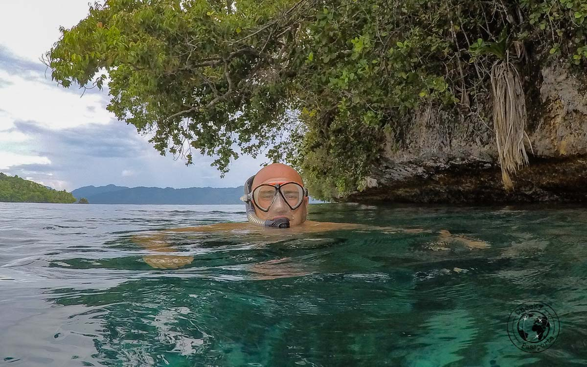 snorkeling at Friwen wall. A good activity to do on a budget in Raja Ampat