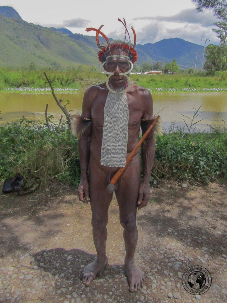 An elderly man dressed in his traditional koteka - The Tribes and Mummies of the Baliem Valley, Papua