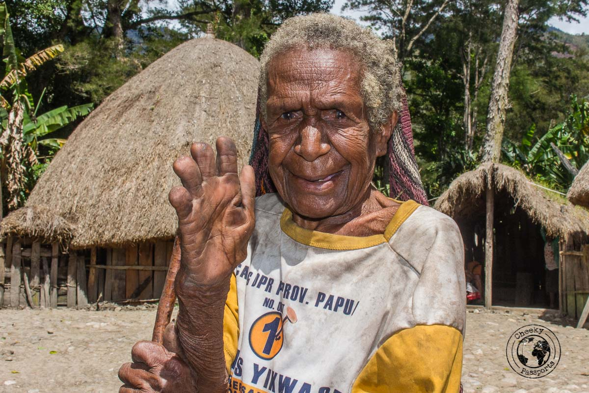 Crushing fingers is a tribal tradition in the Baliem valley - The Tribes and Mummies of the Baliem Valley, Papua