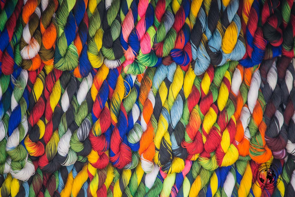Selling colourful threads at the Wamena market - The Tribes and Mummies of the Baliem Valley, Papua