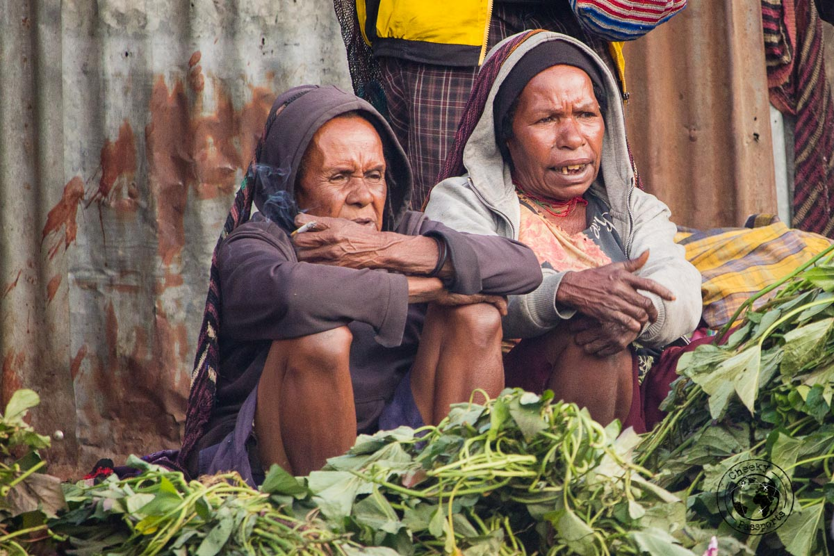 Two women waiting at the wamena market place - The Tribes and Mummies of the Baliem Valley, Papua