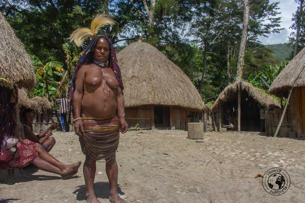 Woman in the traditional tribal dress - The Tribes and Mummies of the Baliem Valley, Papua