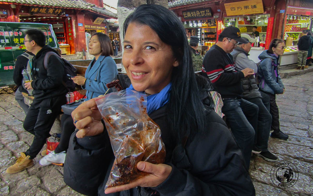Michelle indulging in yak meat - Lijiang attractions, Yunnan, China