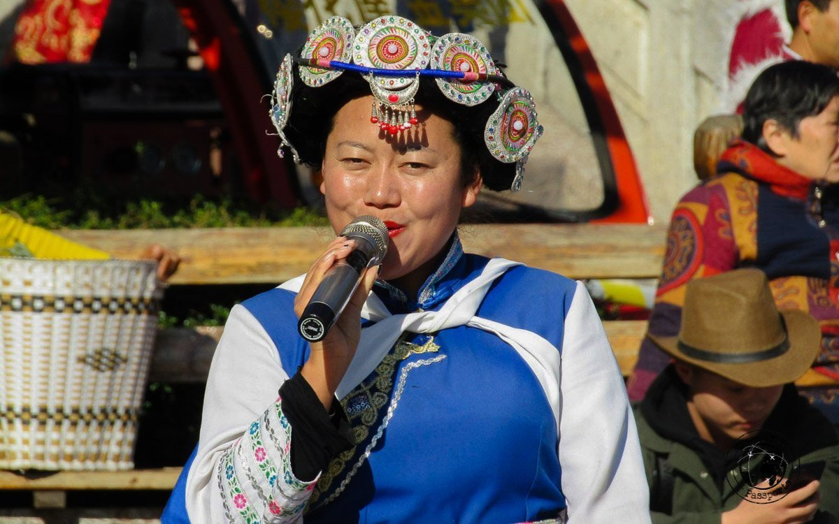 Traditional Naxi dancing in the square - Lijiang attractions, Yunnan, China
